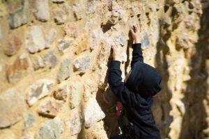 Child climbing wall